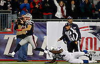 New England Patriots wide receiver Julian Edelman (11) escapes a tackle by Indianapolis Colts running back Delone Carter (34) on a 68-yard touchdown on a punt return in the second quarter at Gillette Stadium in Foxboro, Massachusetts on November 18, 2012.  UPI/Matthew Healey