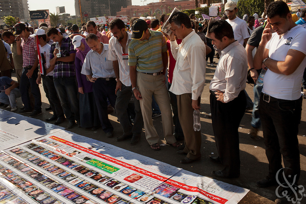 Egyptians look at the images of those who were killed during the January revolution as they take part in a large July 8, 2011 protest in Tahrir Square in downtown Cairo, Egypt. Many of the protesters have vowed to stay in the square until the demands of the revolution are met, including an end to military trials of civilians, prosecution of police officers accused of murder or torture and open trials of former regime officials including ex-President Hosni Mubarak. (Photo by Scott Nelson/Der Spiegel)