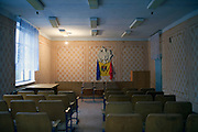 A Moldovan flag is seen in an empty conference room in Dereneu.