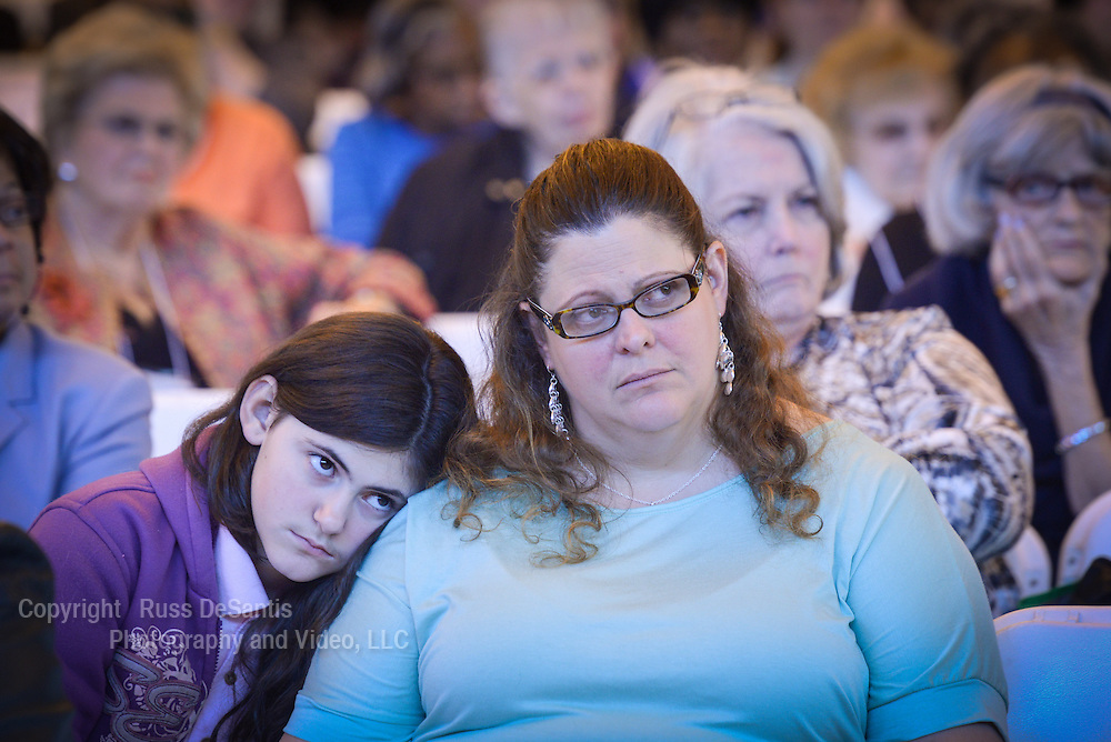 Sasha Fanego, 12, of LIttle Ferry, NJ, rests her head on her mothers shoulder. Her mother is Christina Fanego. The Women's Commission of the Archdiocese of Newark held a Day of Reflection on April 26, 2014 at the Ritchie Regan Recreation and Athletic Center on the campus of Seton Hall University, South Orange, NJ. /Russ DeSantis Photography and Video, LLC