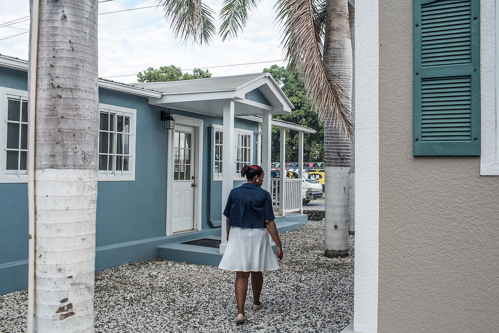 A woman shows earthquake- and hurricane-resistant model homes available for sale from ShelterIt, a Florida-based company, on Wednesday, December 17, 2014 in Port-au-Prince, Haiti.
