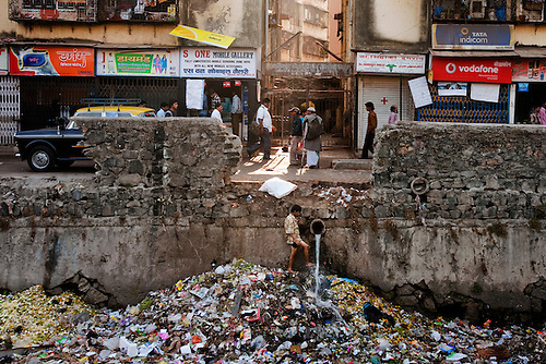 slum area development For mumbai, in an area of 437 sq kms having a population of around 11 million, conservative estimates put over fifty-five percent as slum population.