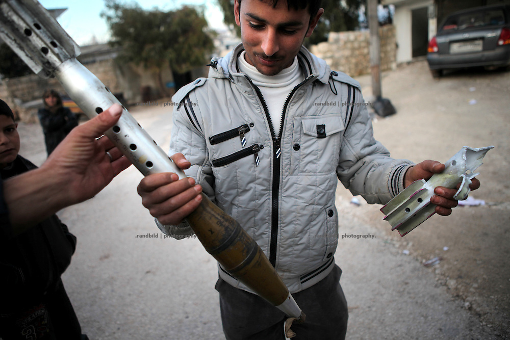 A young man found an unexploded RPG grenate. On 22. February the syrian army attacked the village of Kureen, Province of Idlib, Syria. Kureen was among the first villages in the northwest of Syria controlled by the opposition. Some villagers and members of the defence units escaped to surrounding olive orchards, when the attack begun in the early morning. A majority of the inhabitants didn´t manage to escape. The heavy shelling lasts 7 houres. Soldiers searched all houses, burnt some of them down, loote shops, stole cars and furniture. About 60 motorcycles were burnt down. Tanks demolished several houses. 6 men were executed. One woman died as a result of an heart attack.