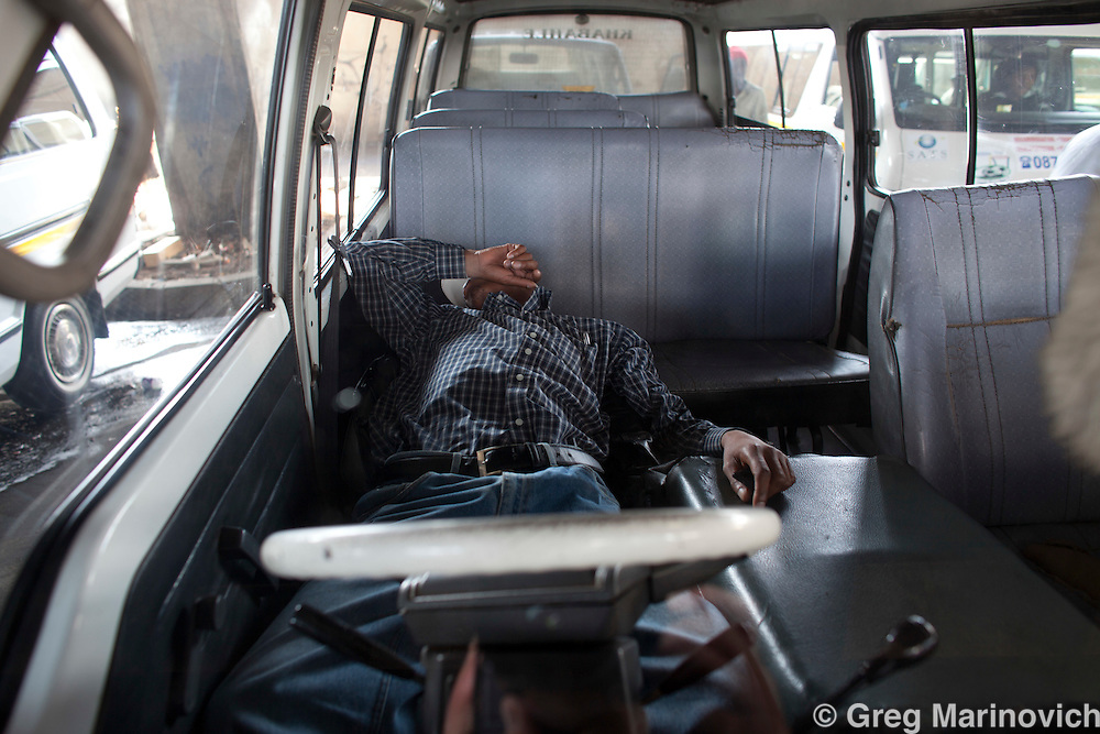 The WATA taxi associations rank under the M2 highway in downtown Johannesburg. The minibus taxis are Jozi's ubiquitous public transport, rough and ready, like the city. Johannesburg, August 12, 2010. Photo Greg Marinovich / StoryTaxi.com