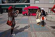 Young girls taking a photo in Hiroshima