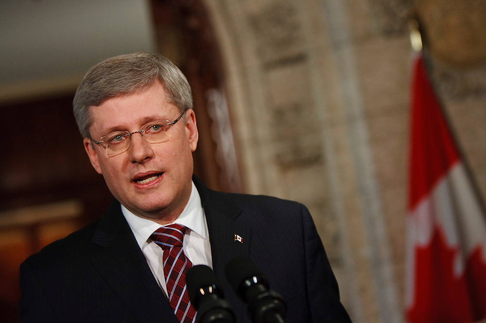 Prime Minister Stephen Harper speaks to the media at a press conference in the foyer of the House of Commons in Ottawa, Canada following the fall of his government in a non confidence vote March 25 2011. <br /> AFP/GEOFF ROBINS/STR