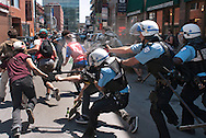 Montreal riot police gas and attempt to arrest a small group of student protesters who had been walking and chanting slogans in the streets during the Montreal Formula demonstrations. Montreal, June 10, 2012.