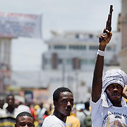 A young man holds up a vintage pistol  prior to the parade held on the occasion of the annual Oguaa Fetu Afahye Festival in Cape Coast, Ghana on Saturday September 6, 2008.