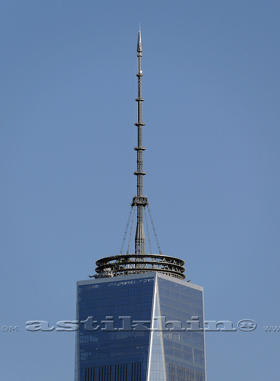Top of Freedom tower with communications antenna tower sky background.