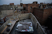Daybreak in the 'Old City' sector of Lahore. Resident take to sleeping on the roofs as constant load-shedding / power outages and the lack of air conditioning or fans make sleeping indoors during the current hot spell unbearable..
