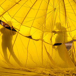 113012       Brian Leddy.Volunteers help inflate a balloon Friday morning during the Red Rock Balloon Rally.