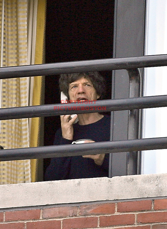 """""""Coffee, Tea or MICK??"""" Friday the 13th finds Rolling Stone Mick Jagger peering out his Four Seasons' Hotel presidential suite window in Boston just hours before tonite's show. photo by Mark Garfinkel  October 26, 2006"""
