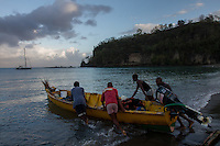 Anse La Raye, Saint Lucia: Fishermen launch their boats shortly after dawn.