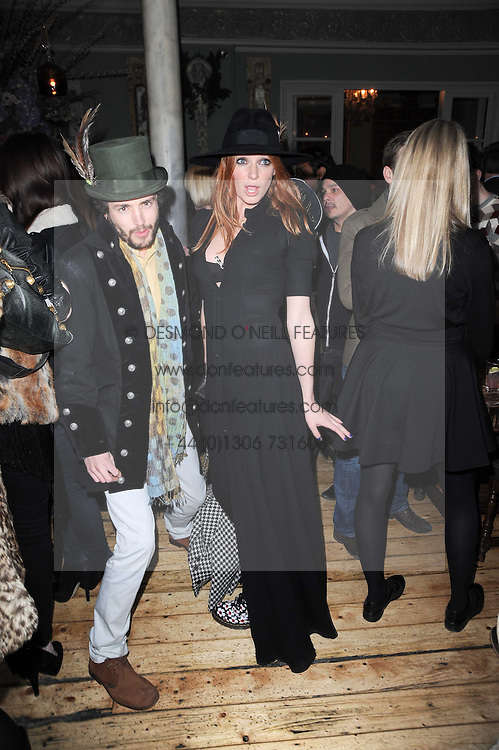 OLIVIA INGE and JAMES BUCHANAN at a party to celebrate the 1st anniversary of Alice Temperley's label held at Paradise, Kensal Green, London W10 on 25th November 2010.
