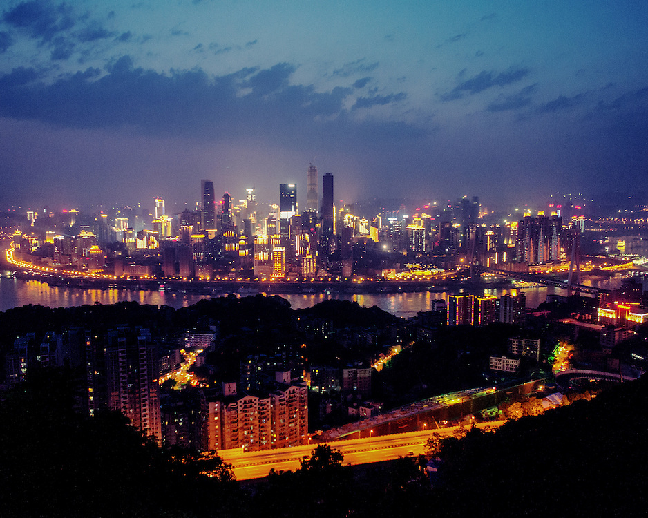 One Tree Hill scenic spot at night overlooking the Chongqing cityscape.