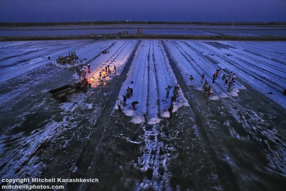 Aerial drone image of salt workers in salt pans near Dwarka, Gujarat, India.