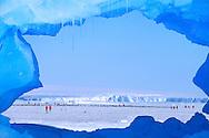 Tourists visiting emperor penguin colony, Weddell Sea, Antarctica