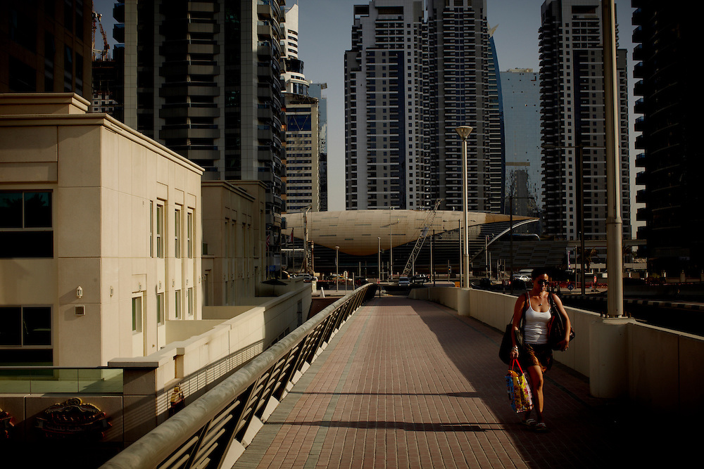 A woman walking in Media City Dubai...Photo by: Eivind H. Natvig/MOMENT