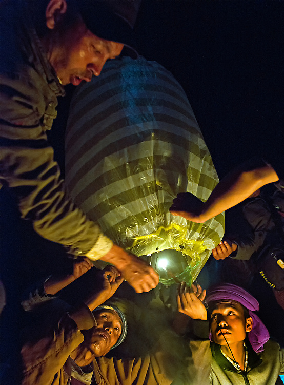 Men prepare to launch hot air balloons as a celebration in the Shan state, Myanmar.