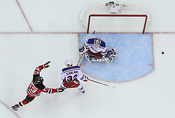 May 21, 2012; Newark, NJ, USA; New Jersey Devils right wing David Clarkson (23) celebrates a goal by New Jersey Devils defenseman Bryce Salvador (24) on New York Rangers goalie Henrik Lundqvist (30) during the first period in game four of the 2012 Eastern Conference Finals at the Prudential Center.  The Devils defeated the Rangers 4-1.
