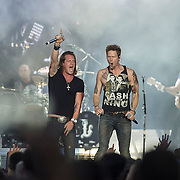 "WASHINGTON, DC - July 25, 2014 - Brian Kelley and Tyler Hubbard of Florida Georgia Line perform at Nationals Park in Washington, D.C. as part of Jason Aldean's Burn It Down Tour. The duo have had multiple singles top the US Country charts, including ""Cruise"" and ""This is How We Roll."" (Photo by Kyle Gustafson / For The Washington Post)"