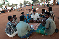 People displaced by the war between the government of Sri Lanka and the LTTE play cards in a camp for internally displaced people at the Menick farm near Vavuniya, Sri Lanka on July 8, 2009. Nearly 300,000 people remain in camps after the war as the government works on resettling them and screening for remaining LTTE members.