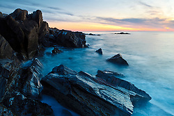 Dawn, rocks, and surf. Wallis Sands State Park, Rye, New Hampshire.