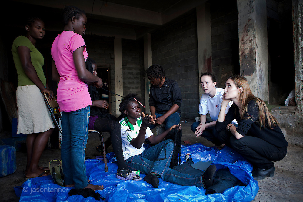 Libya: Actress and UNHCR goodwill ambassador Angelina Jolie talks with a group of displaced Nigerian women at Tripoli's Janzur Port on Wednesday.<br /> <br /> On the last of a two day trip to Libya, Angelina spoke with displaced persons men and women from both Nigeria and Mali. They raised concerns about repatriation and the ability to legally remain in Libya as well as sharing the experiences of the conflict during the past several months and discussing the challenges that lay ahead.<br /> <br /> <br /> &copy;J Tanner 2011