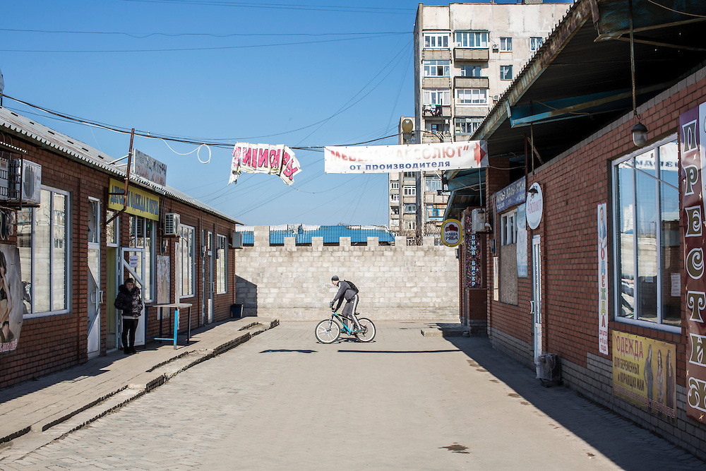 Foot traffic was relatively light at the Kievsky Market, which on January 24 suffered a direct hit by a number of Grad rockets, on Sunday, March 8, 2015 in Mariupol, Ukraine. Photo by Brendan Hoffman, Freelance