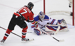 May 19, 2012; Newark, NJ, USA; New York Rangers goalie Henrik Lundqvist (30) makes a save on New Jersey Devils left wing Ilya Kovalchuk (17) during the second period in game three of the 2012 Eastern Conference Finals at the Prudential Center.