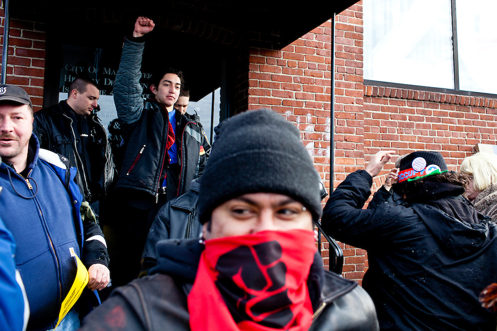 Occupy protesters disperse after police threatened them with arrest at a die in staged at the offices of Organizing for America, President Obama's re-election organization, on Monday, January 9, 2012 in Manchester, NH. Brendan Hoffman for the New York Times