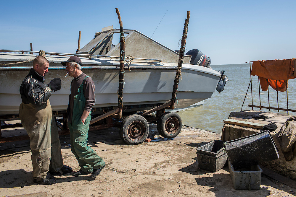 Fishermen with one of their fishing boats on Saturday, April 11, 2015 in Siedove, Ukraine.