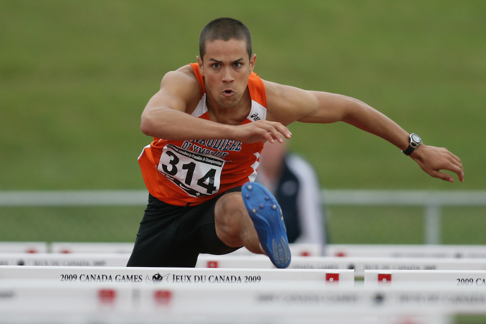 (Charlottetown, Prince Edward Island -- 20090717) Hubert Chevrette-Belisle of Lanaudiere-Olympique competes in the sprint hurdles at the 2009 Canadian Junior Track & Field Championships at UPEI Alumni Canada Games Place on the campus of the University of Prince Edward Island, July 17-19, 2009.  Copyright Sean Burges / Mundo Sport Images , 2009...Mundo Sport Images has been contracted by Athletics Canada to provide images to the media.
