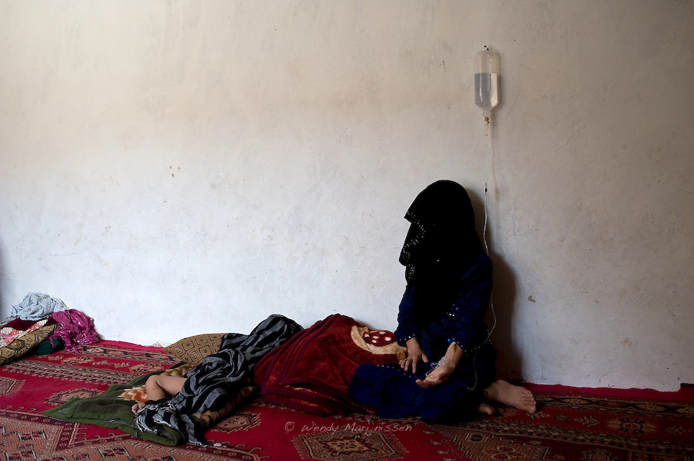 A 22 year old woman imprisoned for running away from her husband and accused of adultery receives an iv in the Faizabad jail. Approximately 400 women and girls are imprisoned in Afghanistan for 'moral crimes'. These 'crimes' usually involve flight from unlawful forced marriage or domestic violence. Some women and girls have been convicted of zina, sex outside of marriage, after being raped or forced into prostitution. Badakshan, Afghanistan, 2012