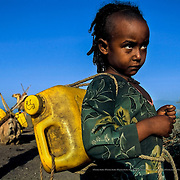 Almas is eight years old. She goes out looking for water twice every day, in the early morning and at noon and spends more than five hours total travelling back and forth for water. She had to stop going to school because she didn't have enough time. Raya-Mehoni, Ethiopia.