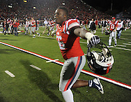 Mississippi defensive tackle Woodrow Hamilton (56) celebrates a win over LSU at Vaught-Hemingway Stadium in Oxford, Miss. on Saturday, October 19, 2013. Mississippi won 27-24. (AP Photo/Oxford Eagle, Bruce Newman)