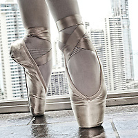 Detail of a pair of ballet shoes.MR. Model relased photo.