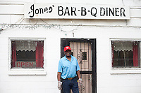 James Beard award winner and 3rd generation BBQ pitmaster, James Jones standing outside his diner in Marianna, Arkansas.