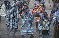 A group of aboriginal dancers in colourful print dresses dance at the Laura Festival in Cape York, far north Queensland, Australia