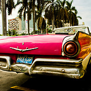 Historic American cars, many serving as taxis, create a time warp as they roam the streets of Havana, Habana, Cuba.