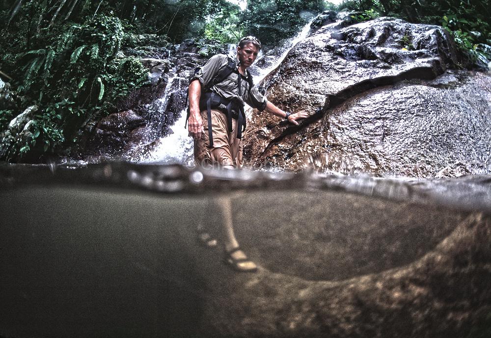 Shannon Walsh wades across a jungle pool while exploring Tioman Island off the coast of Malaysia.
