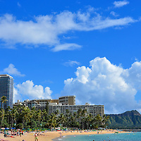 Waikīkī Beach and Diamond Head in Honolulu, O&rsquo;ahu, Hawaii <br /> Waikīkī, which means &ldquo;Spouting Water,&rdquo; was named for the Kuekaunahi stream that once filled this area with fresh water.  This 1.5 mile stretch on O&rsquo;ahu Island&rsquo;s south Pacific shore is lined with high-rise hotels, time-shares and condominiums that house all of the international tourists that come for the sandy beach, warm sun, high-end shopping and views of the dormant volcanic mountain called Diamond Head or Lē&rsquo;ahi.