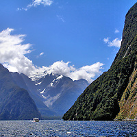 Boat Sailing through Milford Sound, New Zealand<br />