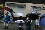 Peace demonstration, and Anti-War demonstration, in the rain, Hibiya Park, Tokyo on the one year anniversary of the USA led war on Iraq.