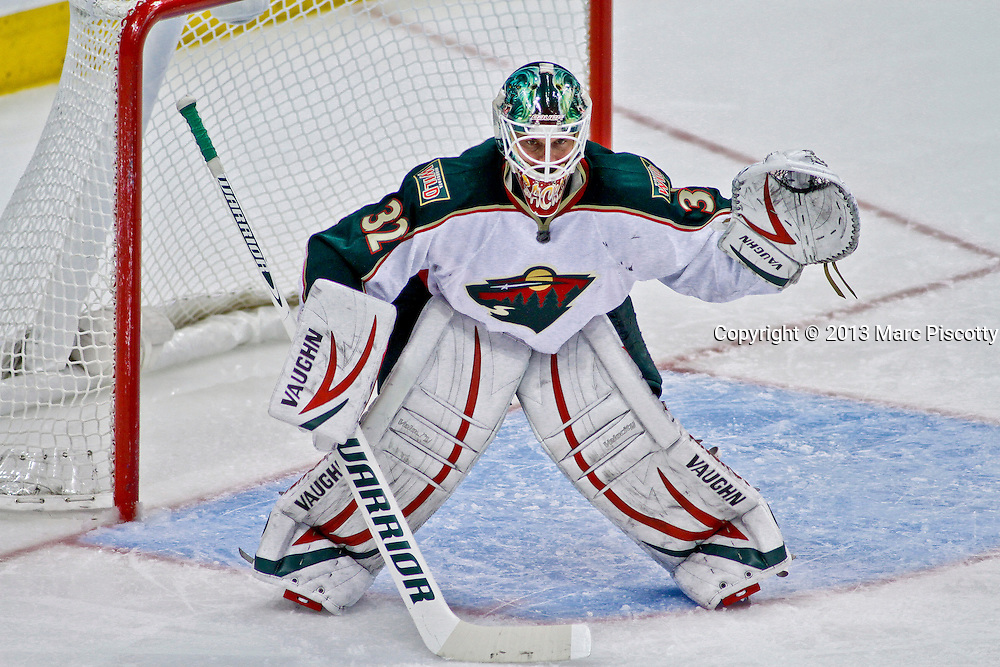 SHOT 3/16/13 3:09:16 PM - The Minnesota Wild's Niklas Backstrom #32 prepares for a face off in his own zone while playing against the Colorado Avalanche during their regular season NHL game at the Pepsi Center in Denver, Co. The Minnesota Wild won the game 6-4. (Photo by Marc Piscotty / © 2013)