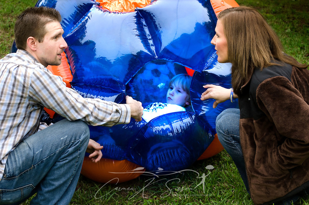 Corey Perrigin and Ashley Birckbichler try to convince their son, Elisha Perrigin, that it's time to go home, April 21, 2012, at Corey Perrigin's house in New Hope, Miss. Perrigin and Birckbichler, along with Birckbichler's husband, Andrew Birckbichler, remain in close contact in order to provide stability for Elisha, who has been diagnosed with Asperger Syndrome, a form of autism. (Photo by Carmen K. Sisson/Cloudybright)