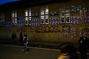 A popular wall for political posters and graffiti in Vushtrri, Kosovo.
