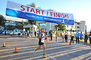 BELLVILLE, SOUTH AFRICA - Wednesday 3 December 2014, Duran Byman coming in second place during the Metropolitan 10km road race outside the Parc Du Cap head office in Bellville.<br /> Photo by IMAGE SA / Roger Sedres