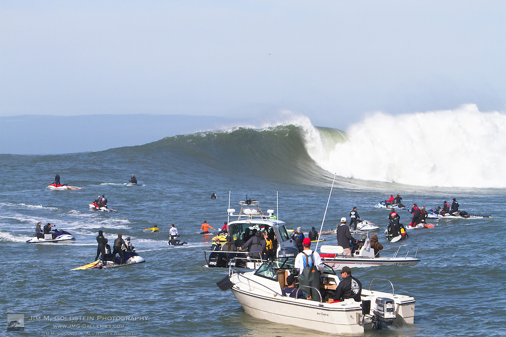 Crowded waters with water patrol, Pillar Point rescue, spectators and photographers in jet skis and boats at the Mavericks Surf Contest held in Half Moon Bay, California on February 13, 2010