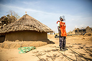 Michael Adeep Makuer, an UNMAS Deminer, is pictured standing by in case of an emergency, while clearance operations are conducted. UNMAS began clearance of Jebel Kujur, outside of Juba, South Sudan, in January 2017 to ensure the safety of returnees and to enable them to rebuild their lives following the intense fighting in Juba in July 2016, which littered the area with explosive remnants of war. Children searching for scrap metal, a source of income, found unexploded ordnance such as rocket propelled grenades, 80mm recoilless projectiles, and small arms ammunition, which they reported to security at the local UNMISS base. UNMAS conducted surface clearance due to the amount of scrap, which would have interfered with detectors.<br /> <br /> Photo: UNMAS/ Martine Perret